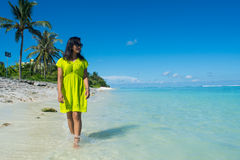 Portrait of young beautiful asian girl walking  on the beach and looking at ocean Royalty Free Stock Images