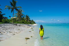 Portrait of young beautiful asian girl walking way on the beach Stock Photography