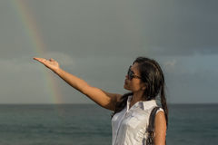 Portrait of a young beautiful asian woman holding rainbow in her hand Stock Photography