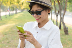 Portrait of young beautiful asian woman and smart phone in hand Stock Photo