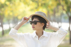Portrait of young beautiful asian woman wearing sun glasses and Royalty Free Stock Image