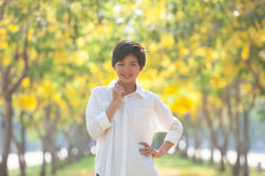 Portrait of young beautiful asian woman with white shirt standin Stock Photo