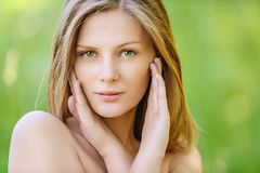 Portrait of young beautiful blond woman Stock Photos