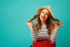 Portrait of young beautiful blond woman in hat with flirting exp Stock Photo