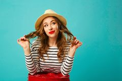 Portrait of young beautiful blond woman in hat looking up over b Royalty Free Stock Photo