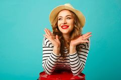 Portrait of young beautiful blond woman in hat with happy expres Stock Images