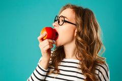 Portrait of young beautiful blond woman in round black glasses e Royalty Free Stock Image