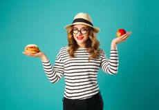 Portrait of young beautiful blond woman wearing glasses and hat Royalty Free Stock Image
