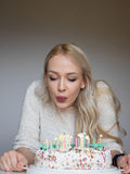 Portrait of a young beautiful blonde girl on birthday Stock Images