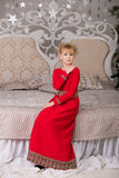 Portrait of a young beautiful blonde in a red dress at the Chris Stock Photo