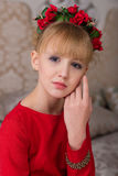 Portrait of a young beautiful blonde in a red dress at the Chris Royalty Free Stock Images