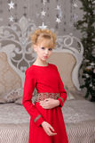 Portrait of a young beautiful blonde in a red dress at the Chris Stock Photos