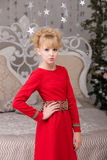 Portrait of a young beautiful blonde in a red dress at the Chris Royalty Free Stock Photo
