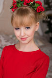 Portrait of a young beautiful blonde in a red dress at the Chris Royalty Free Stock Image