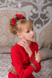 Portrait of a young beautiful blonde in a red dress at the Chris Stock Images