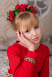 Portrait of a young beautiful blonde in a red dress at the Chris Stock Image
