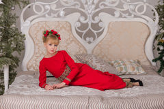 Portrait of a young beautiful blonde in a red dress at the Chris Royalty Free Stock Photography