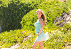 Portrait of young beautiful blonde woman, on green background summer nature Stock Image