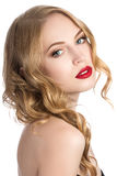 Portrait of young beautiful blonde woman. Looking over her shoulder royalty free stock photos
