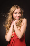 Portrait of young beautiful blonde woman in red dress Stock Photos