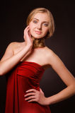 Portrait of young beautiful blonde woman in red dress Royalty Free Stock Images