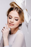 Portrait of young beautiful bridal with natural beauty, nude makeup, big white bow in the  hair Stock Photos