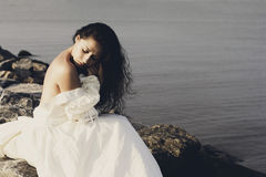 Portrait of young beautiful bride near sea Stock Images
