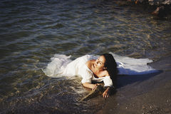 Portrait of young beautiful bride near sea Royalty Free Stock Photos