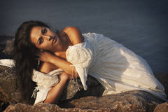 Portrait of young beautiful bride near sea Royalty Free Stock Images