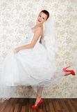 Portrait of young beautiful bride in shoes Stock Photography