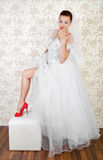 Portrait of young beautiful bride in shoes Stock Photos