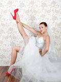 Portrait of young beautiful bride in shoes Royalty Free Stock Photos