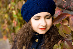 Portrait of young beautiful brunette in beret Stock Images
