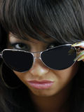 Portrait of a young, beautiful brunette in black glasses. Studio Royalty Free Stock Photo