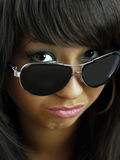 Portrait of a young, beautiful brunette in black glasses. Studio Royalty Free Stock Photos