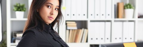 Portrait of young beautiful brunette businesswoman work in office stock photo