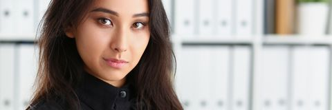 Portrait of young beautiful brunette businesswoman work in office royalty free stock photography