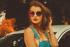 Portrait of young beautiful brunette in sunglasses royalty free stock photo