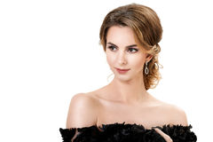 Portrait of young beautiful brunette woman in black dress on white background Stock Photo