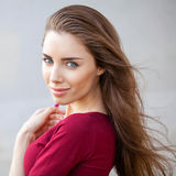 Portrait of a young beautiful brunette woman. Close up, portrait of a young beautiful brunette woman Stock Image