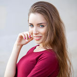 Portrait of a young beautiful brunette woman. Close up, portrait of a young beautiful brunette woman Stock Photography
