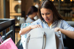Portrait of young beautiful brunette woman in coffee shop Stock Photo