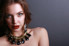 Portrait of young beautiful brunette woman in ear- Stock Images