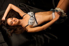 Portrait of a young beautiful brunette woman in lingerie Stock Photography