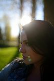 Portrait of young beautiful brunette woman in park.  Royalty Free Stock Photos