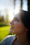 Portrait of young beautiful brunette woman in park.  Stock Photos
