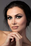 Portrait of young beautiful brunette woman. Putting her chin on hand Royalty Free Stock Photo