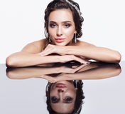 Portrait of young beautiful brunette woman sitting at mirror tab Stock Images