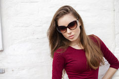 Portrait of a young beautiful brunette woman. Sunglasses fashion. Close up, portrait of a young beautiful brunette woman Stock Images