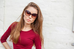 Portrait of a young beautiful brunette woman. Sunglasses fashion. Close up, portrait of a young beautiful brunette woman Royalty Free Stock Photography